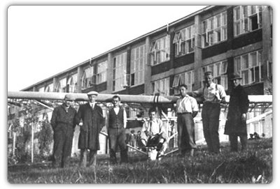 Plane production was initially directed by Mr. Dohnalek and constructed by Mr. Kryšpín. The picture was taken in front of the first school hostel in Zlin.